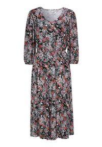 Cellbes Długa sukienka dzianinowa kolorowy we wzory female ze wzorem 42/44. Typ kołnierza: dekolt w kształcie V. Materiał: dzianina. Wzór: kolorowy. Styl: elegancki. Długość: maxi