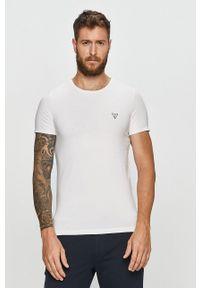 Guess Jeans - T-shirt. Okazja: na co dzień. Kolor: biały. Materiał: jeans. Styl: casual