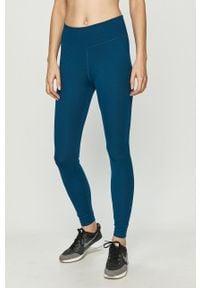 Nike - Legginsy. Kolor: niebieski. Materiał: tkanina, dzianina, poliester, elastan, włókno, skóra. Wzór: gładki #1