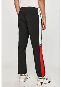 Czarne spodnie dresowe TOMMY HILFIGER z aplikacjami