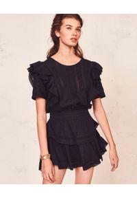 LOVE SHACK FANCY - Czarna sukienka z koronką. Okazja: na imprezę. Typ kołnierza: kołnierz z falbankami. Kolor: czarny. Materiał: koronka. Wzór: koronka. Sezon: lato. Długość: mini