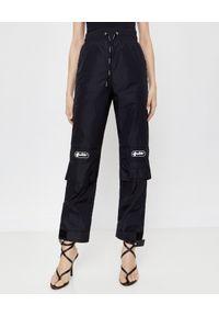 OFF-WHITE - Spodnie dresowe z naszywkami. Kolor: czarny. Materiał: dresówka. Wzór: aplikacja