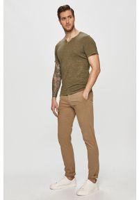 Dr. Denim - Spodnie. Kolor: beżowy