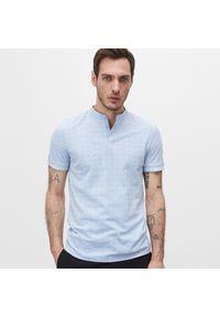 Reserved - Koszulka polo o fasonie slim - Niebieski. Typ kołnierza: polo. Kolor: niebieski