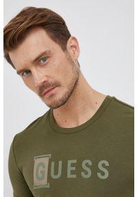 Guess - T-shirt. Kolor: zielony. Materiał: bawełna, dzianina. Wzór: nadruk