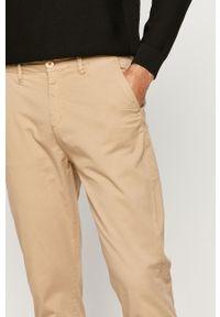 Beżowe spodnie Guess