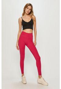 Nike - Legginsy. Kolor: różowy. Materiał: tkanina, dzianina, skóra, włókno. Technologia: Dri-Fit (Nike)