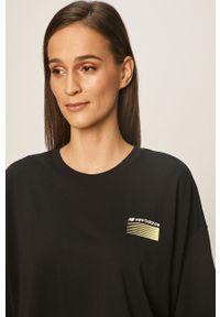 Czarna bluzka New Balance casualowa, z nadrukiem, z okrągłym kołnierzem, na co dzień