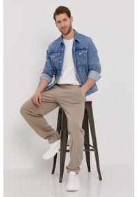 Beżowe spodnie dresowe Reebok Classic gładkie