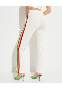 PALM ANGELS - Spodnie dresowe z logo Miami. Kolor: beżowy. Materiał: dresówka. Wzór: kolorowy, aplikacja
