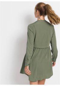 Krótka sukienka szmizjerka bonprix oliwkowy. Kolor: zielony. Długość rękawa: długi rękaw. Typ sukienki: szmizjerki. Styl: elegancki. Długość: mini