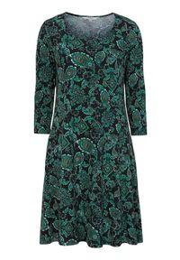 Cellbes Wzorzysta dżersejowa sukienka z bocznymi kieszeniami Czarny zielony wzór paisley female czarny/zielony 58/60. Kolor: wielokolorowy, zielony, czarny. Materiał: jersey. Wzór: paisley. Styl: elegancki