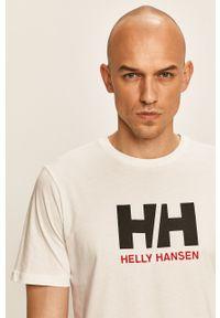 Biały t-shirt Helly Hansen na co dzień, casualowy, z okrągłym kołnierzem, z aplikacjami