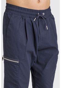 Spodnie dresowe Armani Exchange z aplikacjami