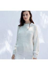 Kremowy sweter Sinsay