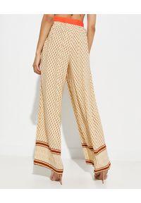 MYSTIQUE BEACH - Szerokie spodnie Desert. Kolor: beżowy. Materiał: szyfon. Wzór: nadruk, aplikacja. Styl: klasyczny, wakacyjny