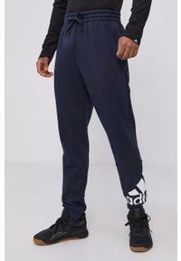 Adidas - adidas - Spodnie. Okazja: na co dzień. Kolor: niebieski. Wzór: nadruk. Styl: casual