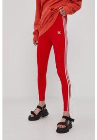 adidas Originals - Legginsy. Kolor: czerwony. Materiał: bawełna, dzianina