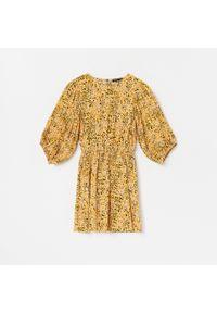 Żółta sukienka Reserved