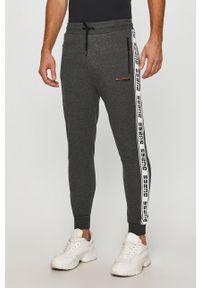 Szare spodnie dresowe Guess Jeans z nadrukiem