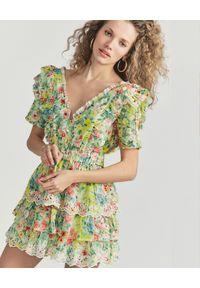 LOVE SHACK FANCY - Wzorzysta mini sukienka Aldina. Typ kołnierza: kołnierz z falbankami. Kolor: żółty. Materiał: bawełna, jedwab. Wzór: kwiaty. Typ sukienki: rozkloszowane. Długość: mini