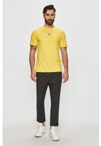 Żółty t-shirt Tommy Jeans casualowy, z aplikacjami