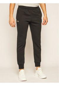 Lacoste Spodnie dresowe XH9507 Czarny Regular Fit. Kolor: czarny. Materiał: dresówka
