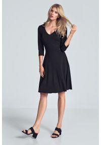 e-margeritka - Sukienka koktajlowa wizytowa czarna - l. Okazja: do pracy. Kolor: czarny. Materiał: poliester, wiskoza, materiał, elastan. Typ sukienki: rozkloszowane. Styl: wizytowy