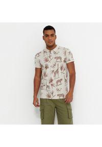 House - Koszulka polo z nadrukiem - Kremowy. Typ kołnierza: polo. Kolor: kremowy. Wzór: nadruk
