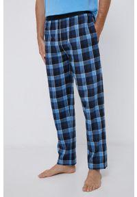 BOSS - Boss - Spodnie piżamowe bawełniane. Kolor: niebieski. Materiał: bawełna