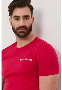 Calvin Klein Jeans - T-shirt. Okazja: na co dzień. Kolor: różowy. Materiał: dzianina. Wzór: gładki. Styl: casual