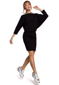 e-margeritka - Dzianinowa sukienka z luźną górą czarna - s/m. Okazja: na co dzień. Kolor: czarny. Materiał: dzianina. Typ sukienki: ołówkowe, dopasowane. Styl: casual. Długość: mini