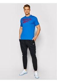 Reebok Spodnie dresowe Essentials Tape GQ4215 Czarny Regular Fit. Kolor: czarny. Materiał: dresówka #2