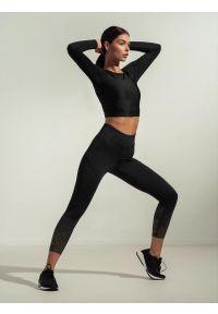 4f - Legginsy treningowe z wysokim stanem damskie Anna Lewandowska x 4F. Stan: podwyższony. Kolor: czarny. Materiał: dzianina, skóra, satyna. Wzór: nadruk