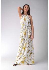 Nommo - Maxi Sukienka w Żółte Kwiaty z Dekoltem Typu Halter. Typ kołnierza: dekolt halter. Kolor: żółty. Materiał: wiskoza, bawełna, elastan. Wzór: kwiaty. Długość: maxi