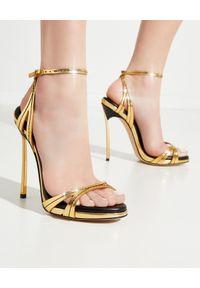 Casadei - CASADEI - Złote szpilki z przeszyciami Blade Jeanne. Zapięcie: pasek. Kolor: złoty. Materiał: lakier. Obcas: na szpilce. Wysokość obcasa: średni
