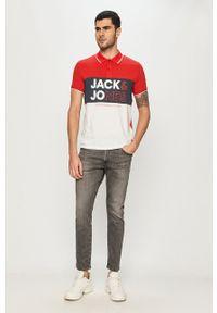 Jack & Jones - Polo. Okazja: na co dzień. Typ kołnierza: polo. Kolor: czerwony. Długość rękawa: raglanowy rękaw. Długość: krótkie. Styl: casual