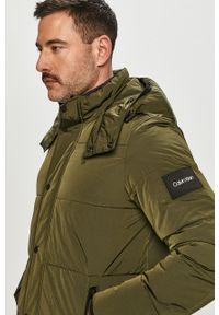 Oliwkowa kurtka Calvin Klein casualowa, z kapturem, na co dzień