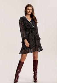 Renee - Czarna Sukienka Nemora. Kolor: czarny. Materiał: koronka, materiał. Długość rękawa: długi rękaw. Wzór: kropki, aplikacja. Typ sukienki: kopertowe. Długość: mini