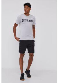 Calvin Klein Performance - T-shirt. Okazja: na co dzień. Kolor: szary. Materiał: skóra. Wzór: nadruk. Styl: casual