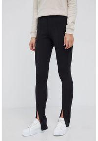 Calvin Klein - Spodnie. Kolor: czarny. Materiał: poliester