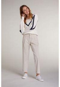 Plisowane beżowe spodnie z wywinięciem u dołu Oui. Kolor: beżowy. Materiał: elastan, bawełna