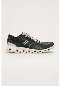 Czarne buty sportowe On Running z okrągłym noskiem, na niskim obcasie, na obcasie