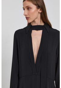Victoria Victoria Beckham - Sukienka. Kolor: czarny. Materiał: tkanina. Długość rękawa: długi rękaw. Wzór: gładki. Typ sukienki: rozkloszowane