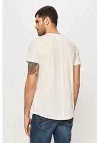 Tommy Jeans - T-shirt. Okazja: na co dzień. Kolor: biały. Materiał: dzianina. Styl: casual