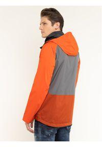 Pomarańczowa kurtka przeciwdeszczowa columbia