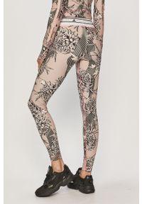 Różowe legginsy Adidas by Stella McCartney