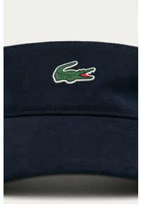 Niebieska czapka z daszkiem Lacoste z aplikacjami