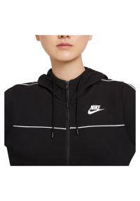 Bluza damska Nike Sportswear Millenium Fleece CZ8338. Typ kołnierza: kaptur. Materiał: poliester, bawełna, materiał. Wzór: gładki, ze splotem