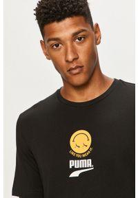 Czarny t-shirt Puma na co dzień, casualowy, z nadrukiem
